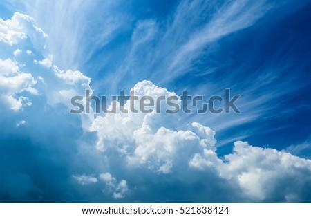 Blue sky with cloud closeup - Shutterstock ID 521838424