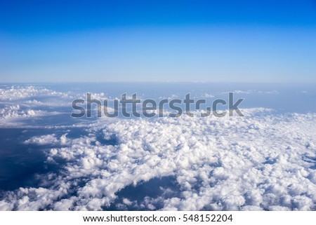 blue sky with cloud view out of airplane #548152204
