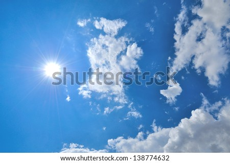 Blue sky with clouds and sun. - Shutterstock ID 138774632
