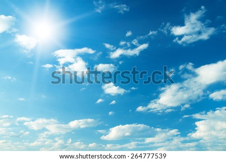 Blue sky with clouds and sun. #264777539
