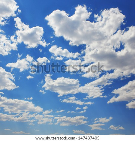 Blue sky with clouds and sun. Background