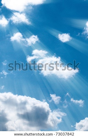 Blue sky with clouds and sun rays