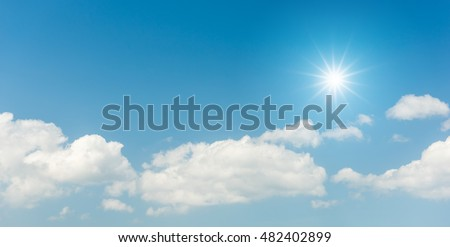 Blue sky with clouds and sun reflection #482402899