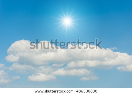 Blue sky with clouds and sun reflection #486500830