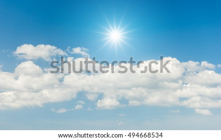 Blue sky with clouds and sun reflection #494668534