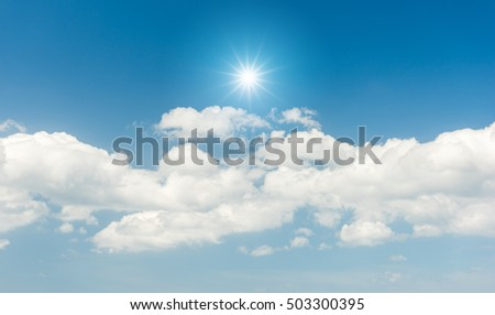 Blue sky with clouds and sun reflection #503300395