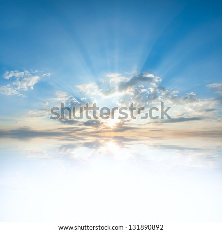 Blue sky with clouds and sun reflection in water with place for your text