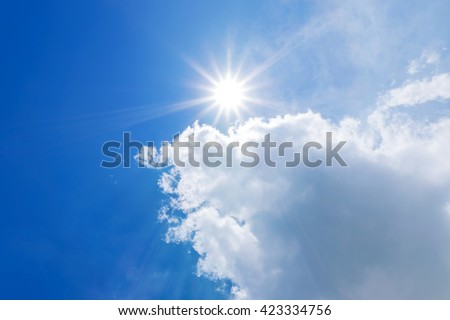 blue sky with clouds and sun reflection.The sun shines bright in the daytime in summer - Shutterstock ID 423334756