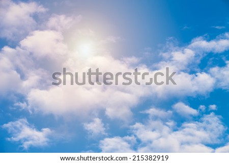 blue sky with clouds and sun shining through the clouds