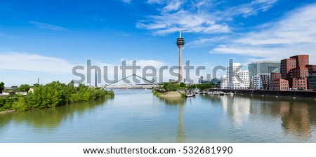 Blue Sky with clouds at summer in Dusseldorf. Rheinturm tower and a bridge, Nordrhein-Westfalen, Germany, Europe. #532681990