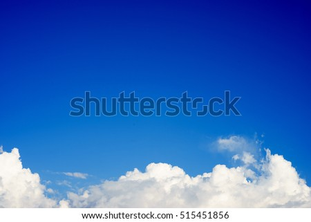 Blue Sky with Clouds at the bottom of the sky.Copy space for text.Use for wallpaper or background. #515451856