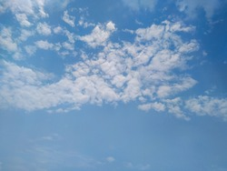 blue sky with clouds background. Scattered clouds in the blue sky.