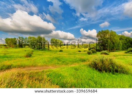 Blue sky with clouds over the hills (rural landscape) #339659684