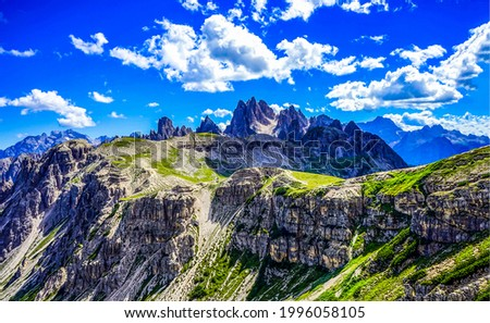 Blue sky with clouds over the mountain peaks. Mountain landscape. Mountain peak rocks. Rocks in mountains