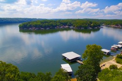Blue sky with clouds reflecting on Lake of the Ozarks Missouri with docks on a summer day