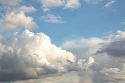 Blue sky with cumulus clouds. Clouds background with copy space.