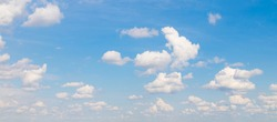 Blue sky with soft white clouds in sunny day. Beautiful Panoramic Nature sky background, texture for Design. Wide Angle Wallpaper or Web banner With Copy Space