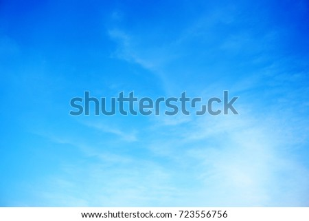 Blue sky with soft white clouds, Nature background - Shutterstock ID 723556756