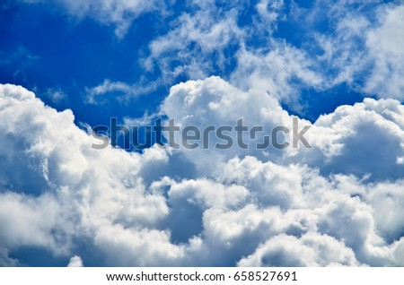 Blue sky with white and gray cumulus clouds. Closeup #658527691