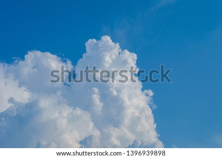 Blue sky with white clouds beautiful background. Dense clouds in blue sky in winter, shaped by the wind.blue sky and wonderful, big densely clouds
