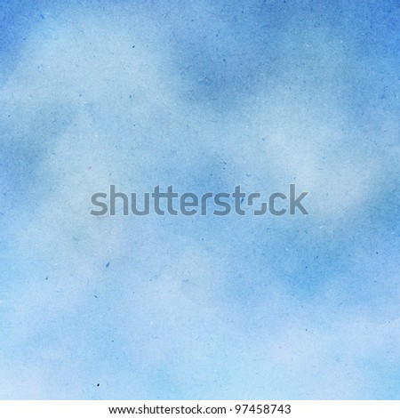 Blue sky with white clouds on grunge recycled paper.