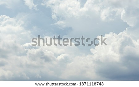 Blue sky with white clouds pattern background. Sky and clouds in daylight. Outdoor natural abstract background. ストックフォト ©