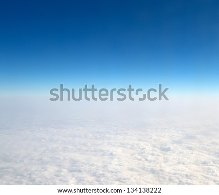 Blue sky with white clouds, space view of the Earth