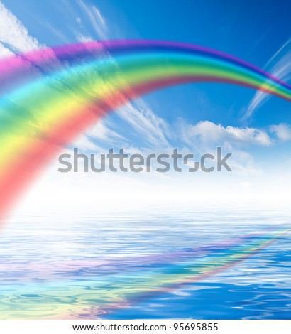 Blue sky with white clouds with rainbow