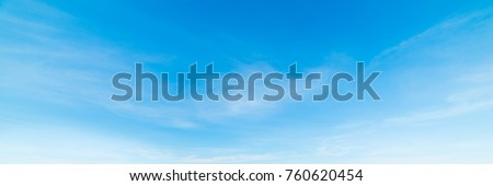 Photo of  blue sky with white, soft clouds