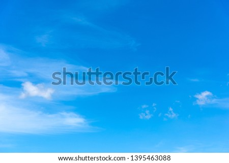 blue sky with white, soft clouds in the springtime