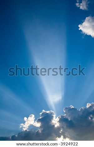 Blue skys and dramatic sunbeams bursting through the haze for a dramatic look