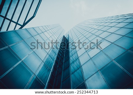 Blue skyscraper facade. office buildings. modern glass silhouettes of skyscrapers