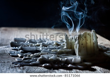 Photo of  Blue smoke with candls on wooden shelf
