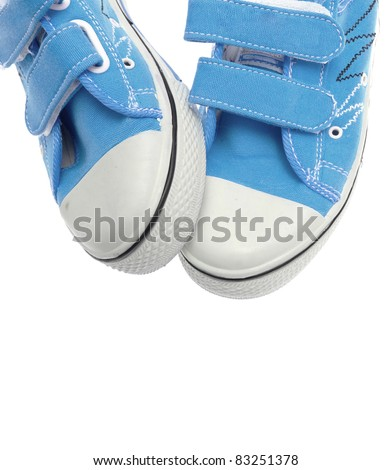 Blue sneakers isolated on white background - stock photo