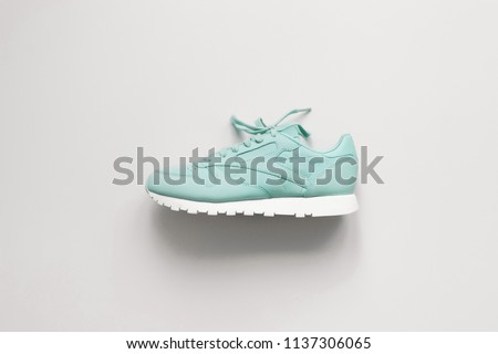 Blue sneakers on white background. Hype sneaker