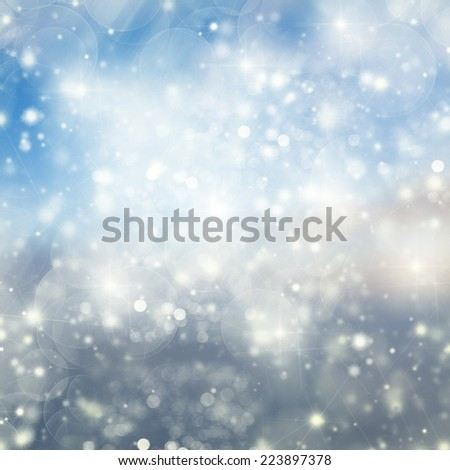 Blue Snow and Lights Festive background with light beams