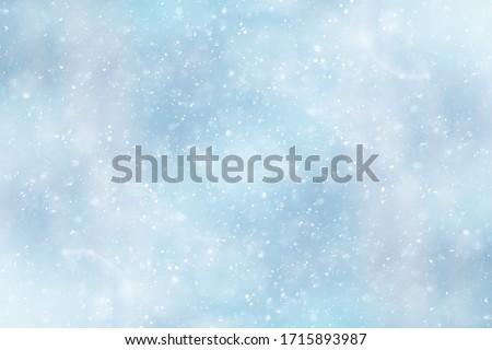 Photo of  blue snowfall bokeh background, abstract snowflake background on blurred abstract blue