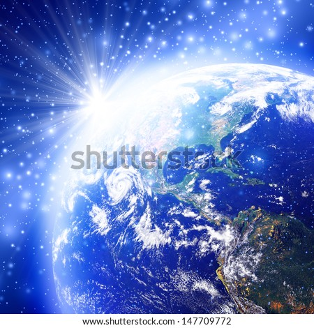 Blue space with the world and sunrise, Earth globe image provided by NASA