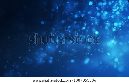 Blue sparkle and mini many glitter falling and float from right scene to left scene on dark background