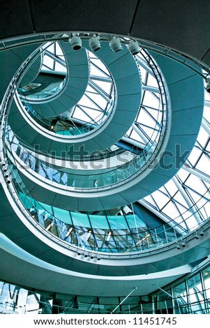Blue spiral stairway in the middle of building