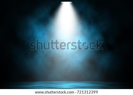 blue spotlight smoke stage...