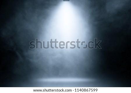 blue spotlight smoke studio entertainment background. #1140867599