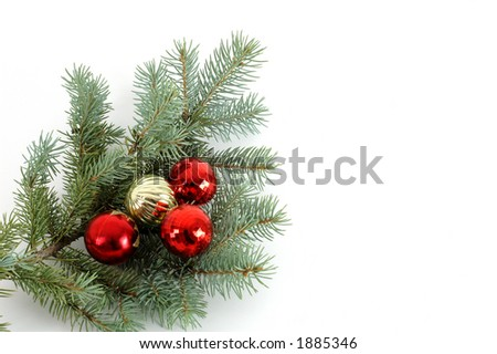 Blue Spruce bough #3 decorated with Christmas ornaments isolated on a white background