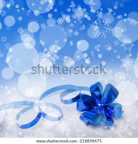 Blue square Christmas gift background with a bow and snowflakes