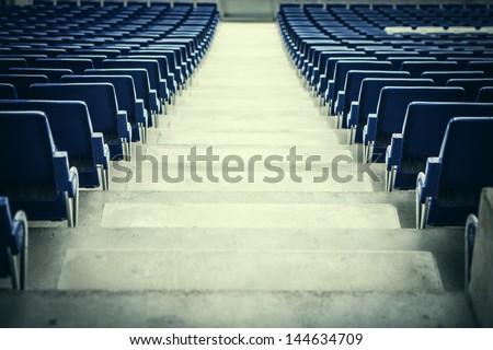 blue stadium seats in a rear...