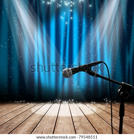 Blue stage with microphone and spotlight