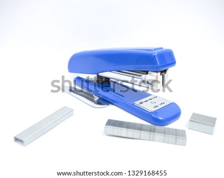Blue stapler and staple of office stationery  isolated on white background