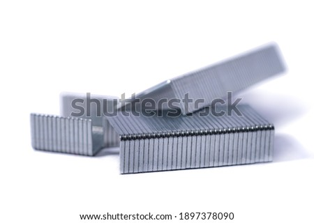 Blue stapler and staples Isolated on white background. Photo stock ©