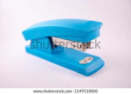 blue stapler on white background