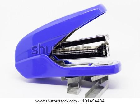 Blue stapler on white background, Stationary stapler